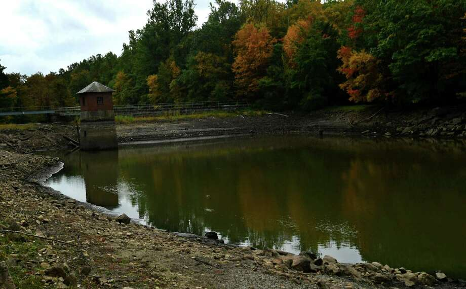 Grupes Reservoir on Saturday, September 26, 2020, in New Canaan, Conn. Norwalk's First Taxing District Water Company is seeking a permit to do repairs on the Grupes Reservoir Dam, originally constructed in 1871. The dam is the fourth in a series of dams along the Silvermine River, and is located next to the Land Trust's Browne Preserve on Valley Road. The current plans call for the dam to be raised by four feet, to prevent water from spilling over the top of the dam in the event of a 500-year flood. The First Taxing District claims that this also necessitates the construction of nearly 1500 feet of berms and walls along the reservoir's eastern bank. Together, the New Canaan Land Trust (NCLT) and Norwalk River Watershed Association (NRWA) are challenging this proposal Photo: Erik Trautmann / Hearst Connecticut Media / Norwalk Hour
