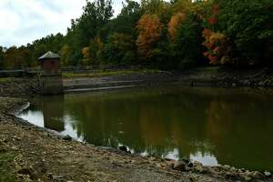Grupes Reservoir on Saturday, September 26, 2020, in New Canaan, Conn. Norwalk's First Taxing District Water Company is seeking a permit to do repairs on the Grupes Reservoir Dam, originally constructed in 1871. The dam is the fourth in a series of dams along the Silvermine River, and is located next to the Land Trust's Browne Preserve on Valley Road. The current plans call for the dam to be raised by four feet, to prevent water from spilling over the top of the dam in the event of a 500-year flood. The First Taxing District claims that this also necessitates the construction of nearly 1500 feet of berms and walls along the reservoir's eastern bank. Together, the New Canaan Land Trust (NCLT) and Norwalk River Watershed Association (NRWA) are challenging this proposal