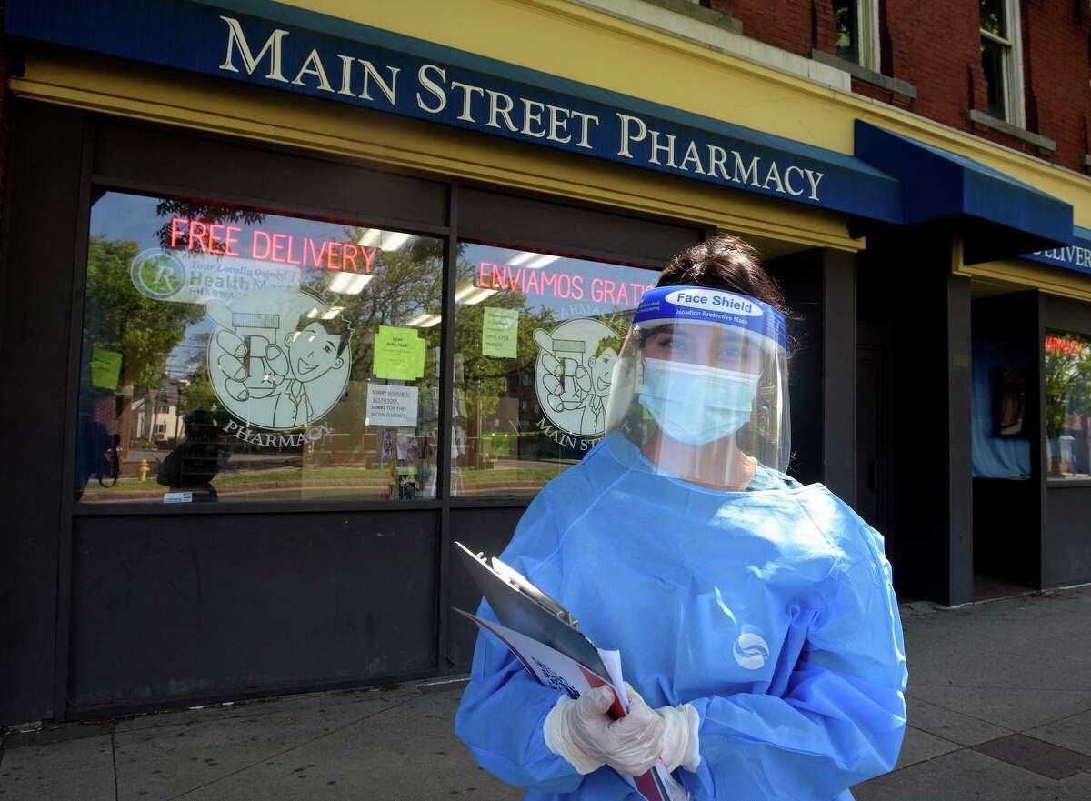 Pharmacy Technician Sabrina Salguero with a self administered coronavirus test at Main Street Pharmacy. Friday, May 22, 2020, in Danbury, Conn.