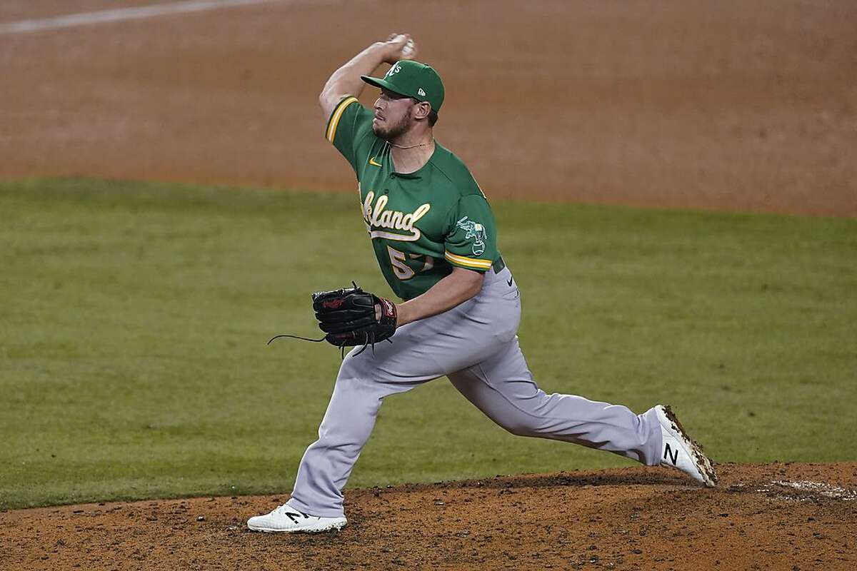 Oakland Athletics relief pitcher J.B. Wendelken throws during the seventh inning of the team's baseball game against the Los Angeles Dodgers on Tuesday, Sept. 22, 2020, in Los Angeles. (AP Photo/Ashley Landis)