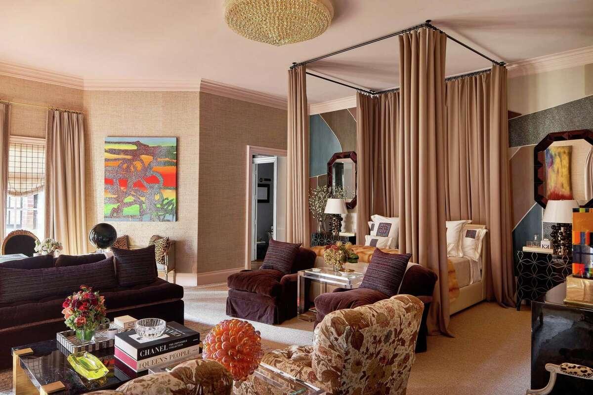 Kirsten Kelli designed the spacious master bedroom in the Kips Bay Decorator Show House Dallas. Phillip Jeffries metallic gold grasscloth wallpaper set the tone.