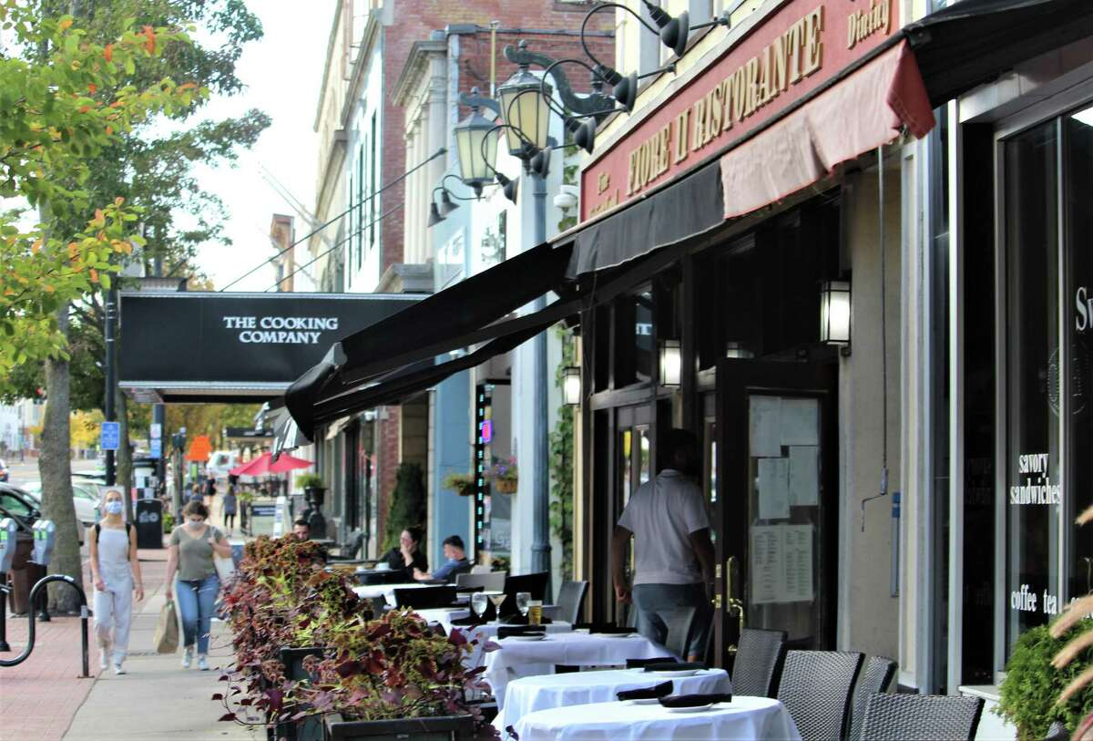 Fiore II Restaurant patrons explore the menu Monday night at 322 Main St., Middletown.