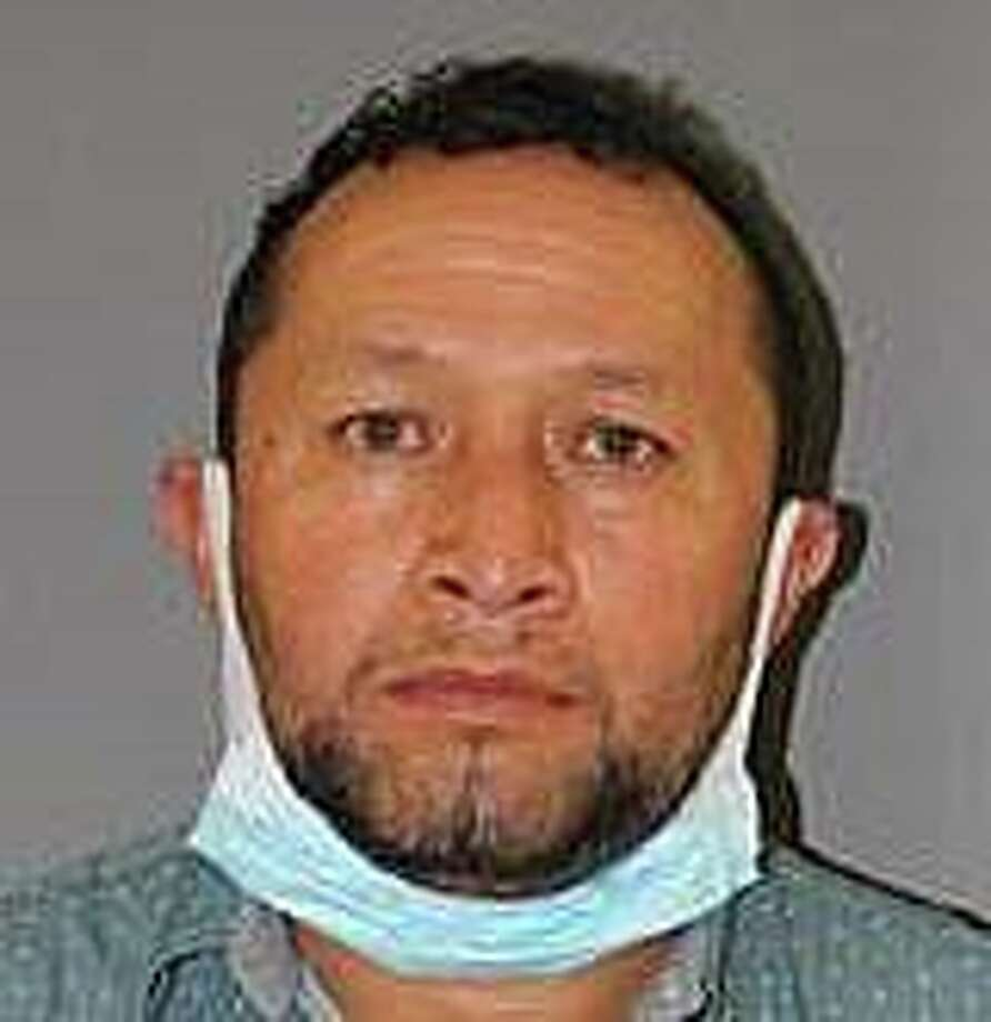 Victor Miguel Siguenzia Lozano, also known as Miguel Lozano Altamiran, was charged with home invasion, first-degree robbery, first-degree burglary, first-degree larceny and first-degree unlawful restraint. Police say he was also charged with conspiracy to commit each of the offenses as well. Photo: Contributed Photo / Wallingford Police Department