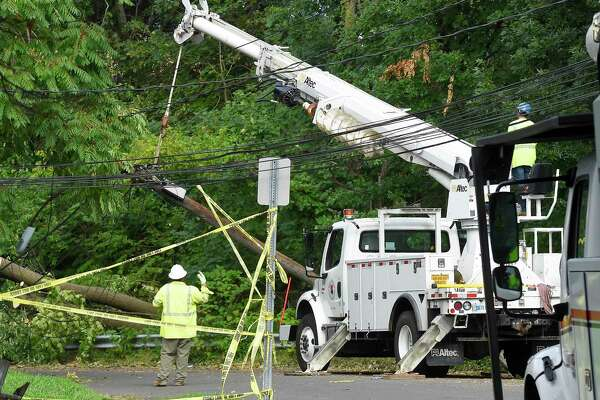 A utility crew works to erect a downed pole on Taylor Street on August 7, 2020 in Stamford, Connecticut. Many out of state crews had to be brought in to assist Eversource in restoring power to the region in the wake of Tropical Storm Isaias.
