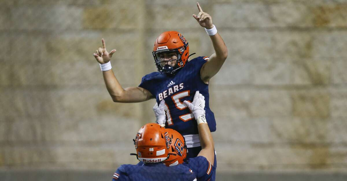 Bridgeland quarterback Conner Weigman (15) celebrates after scoring a rushing touchdown against the Klein Cain defense during the second half of the game at Cy-Fair FCU Stadium on Thursday, Sept. 24, 2020, in Cypress, Texas.