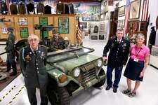 From left, Bill Benson, acting president of the West Haven Veterans Museum & Learning Center, Bob Ellis, treasurer, and Arlene Painter, manager, are photographed next to a Vietnam War-era Jeep at the museum.