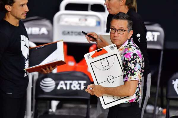 PALMETTO, FLORIDA - SEPTEMBER 27: Head coach Curt Miller of the Connecticut Sun looks to the scoreboard during a timeout in the fourth quarter of Game Four of their Third Round playoff against the Las Vegas Aces at Feld Entertainment Center on September 27, 2020 in Palmetto, Florida. NOTE TO USER: User expressly acknowledges and agrees that, by downloading and or using this photograph, User is consenting to the terms and conditions of the Getty Images License Agreement. (Photo by Julio Aguilar/Getty Images)