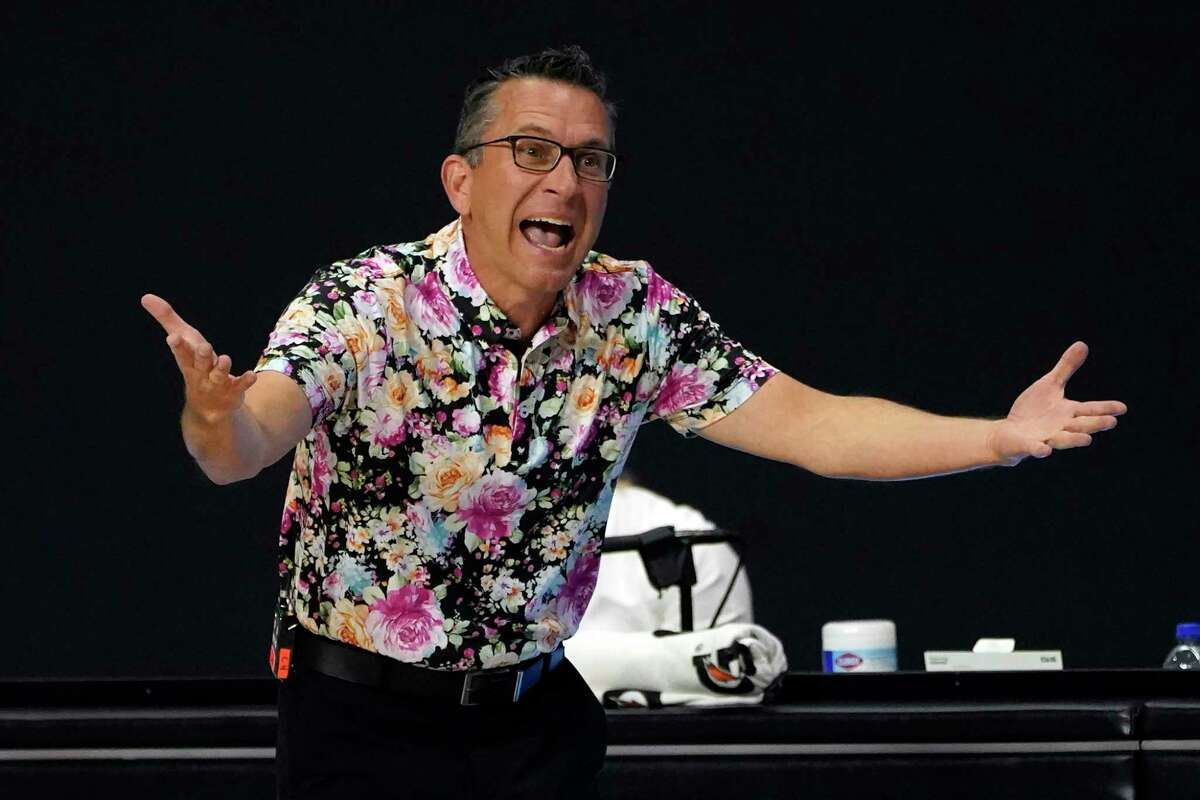 Connecticut Sun head coach Curt Miller questions a foul call against the Las Vegas Aces during the first half of Game 4 of a WNBA basketball semifinal round playoff series Sunday, Sept. 27, 2020, in Bradenton, Fla. (AP Photo/Chris O'Meara)