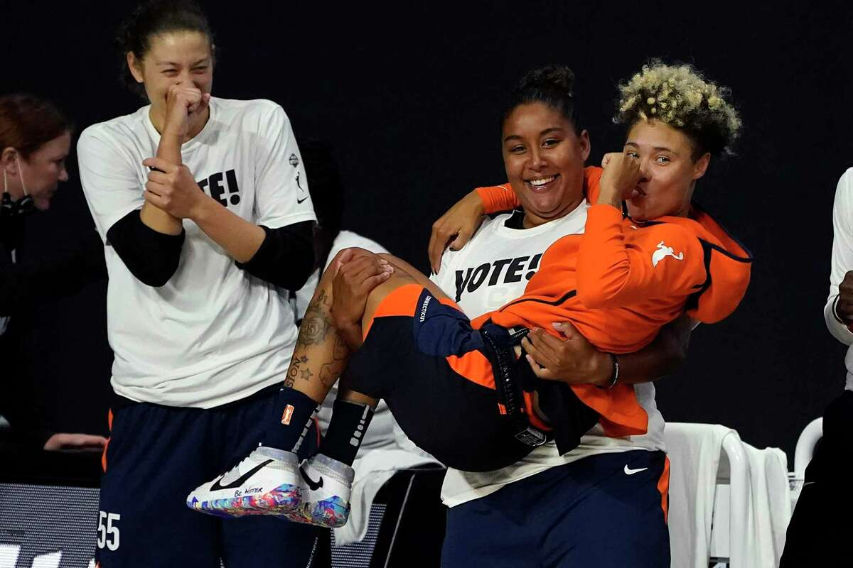 Connecticut Sun guard Natisha Hiedeman (2), forward Kaleena Mosqueda-Lewis (23) and Theresa Plaisance (55) celebrate after basket against the Las Vegas Aces during the first half of Game 4 of a WNBA basketball semifinal round playoff series Sunday, Sept. 27, 2020, in Bradenton, Fla. (AP Photo/Chris O'Meara)