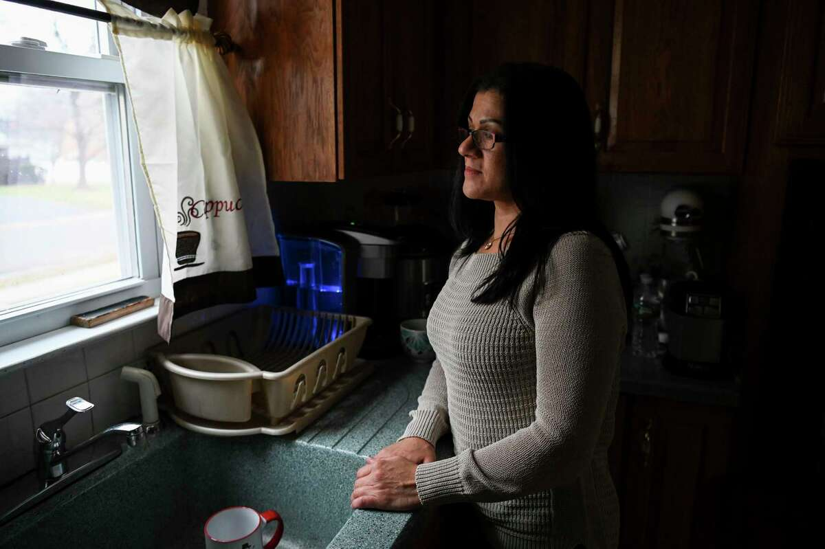 Sandra Diaz, a former employee of the Trump National Golf Club Bedminster and an undocumented immigrant, poses for a portrait in Bound Brook, N.J., in January 2019.