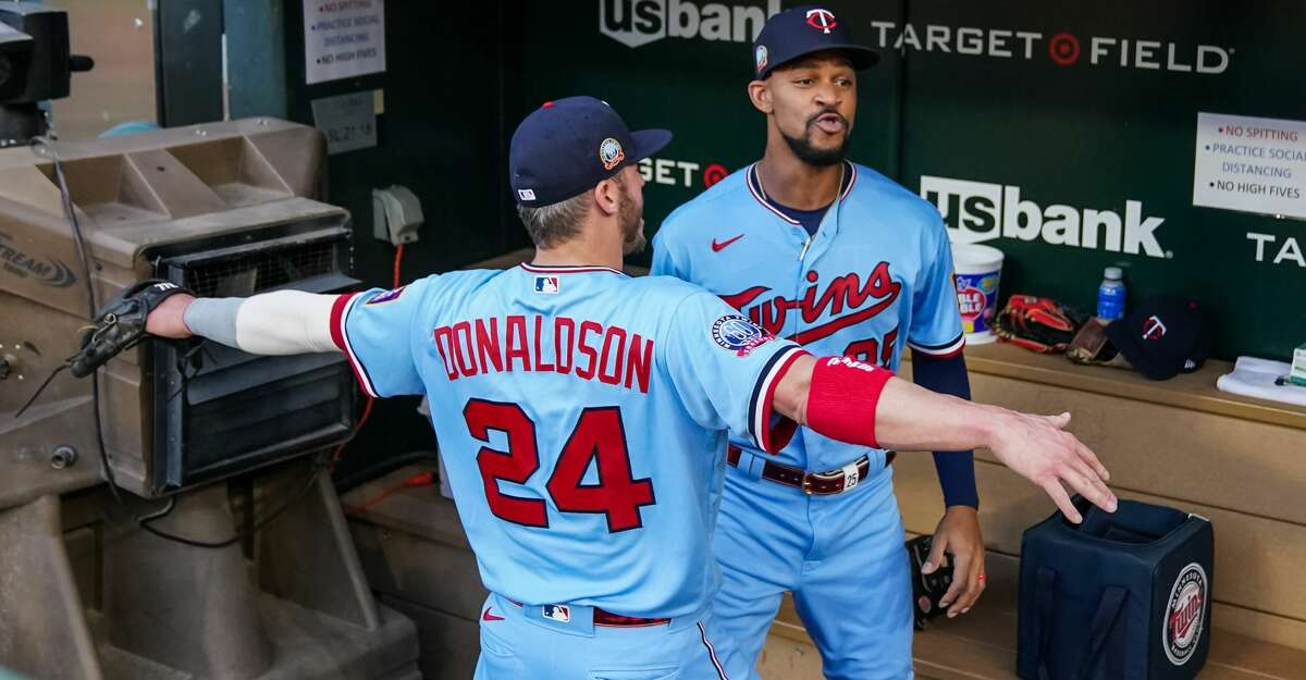 Byron Buxton #25 of the Minnesota Twins looks on with Josh Donaldson #24 against the Detroit Tigers on September 22, 2020 at Target Field in Minneapolis, Minnesota. (Photo by Brace Hemmelgarn/Minnesota Twins/Getty Images)