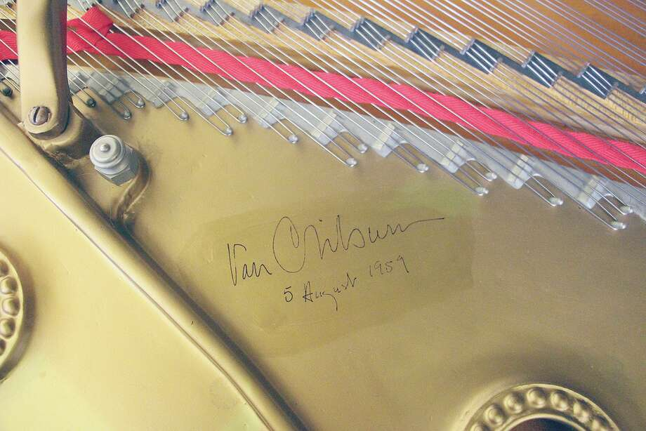 The signature of world-renowned classical pianist Van Cliburn remains on the soundboard of one of two pianos that had been part of MacMurray College since the 1950s. Photo: Provided