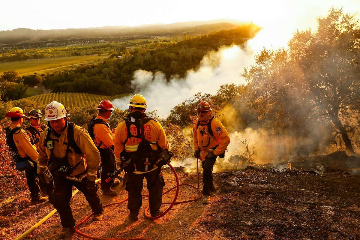Monterey Strike team watches as the Kincade Fire burns in the hills in Geyserville, California, on Thursday, Oct. 24, 2019.