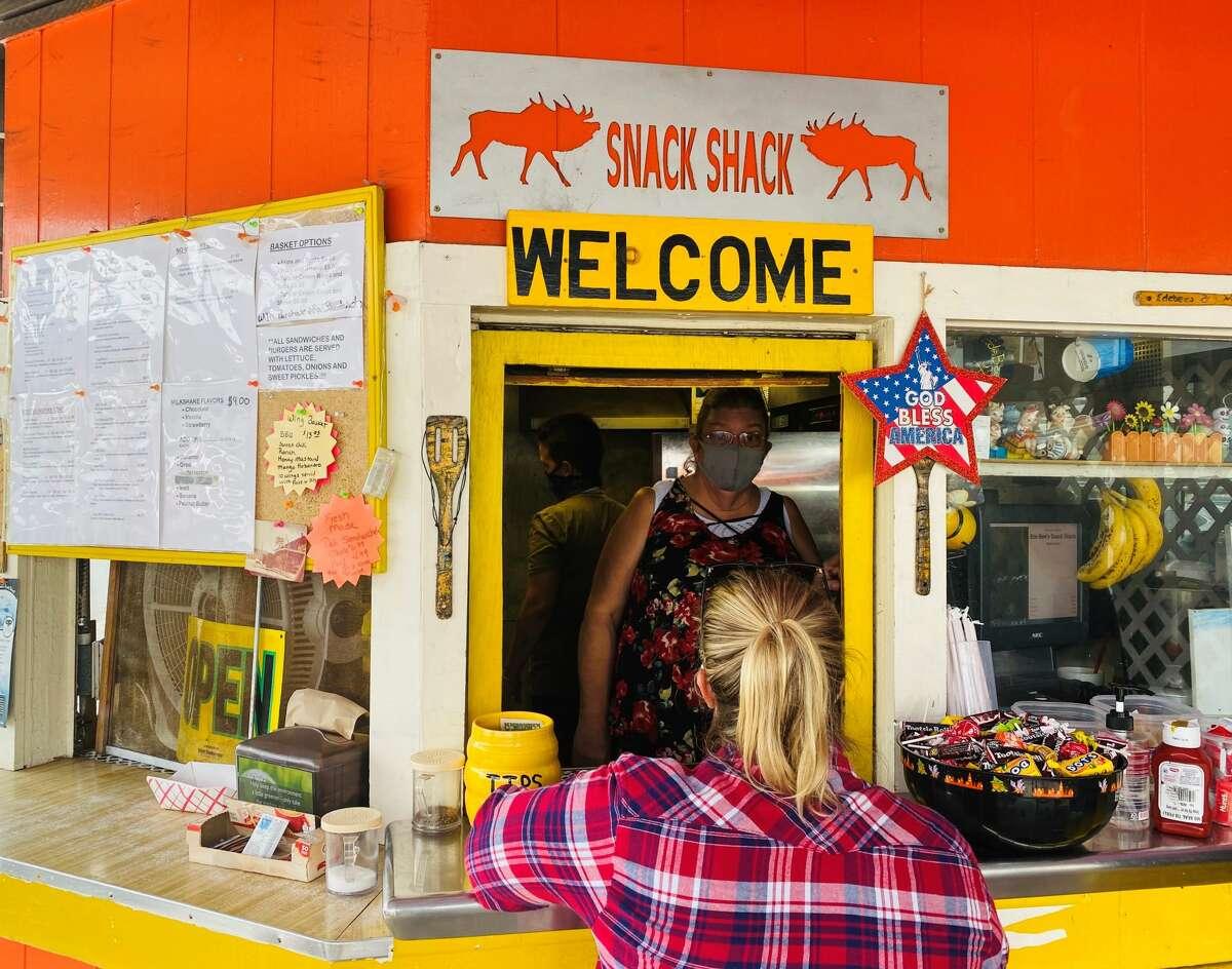 A customer orders an elk burger at Snack Shack in Orick.