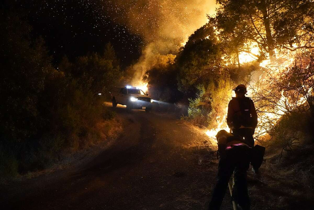 Firefighter strike forces fighting the Glass fire on Sunday, Sept. 27, 2020 in Calistoga, Calif.