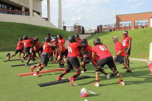 Lamar lineman go through drills Monday during the team's first practice at Provost Umphrey Stadium.