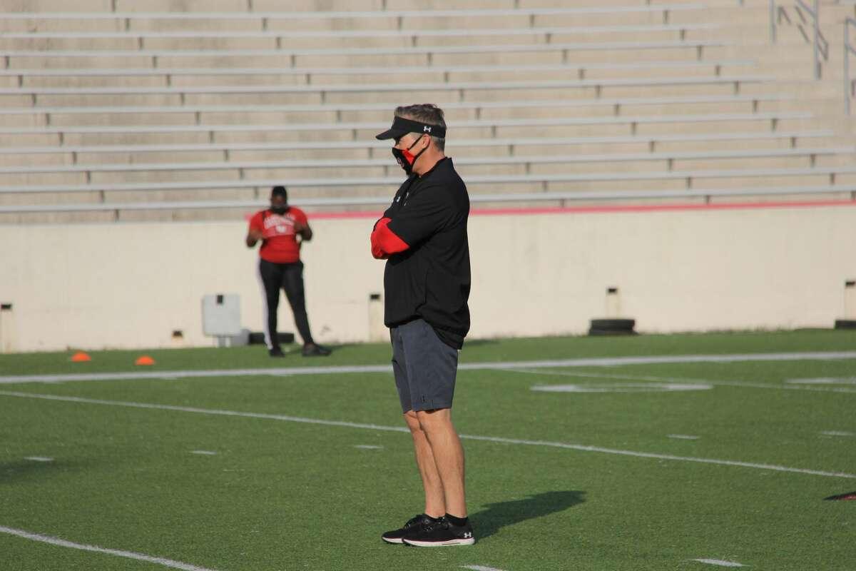 Lamar coach Blane Morgan watches practice Monday at Provost Umphrey Stadium.