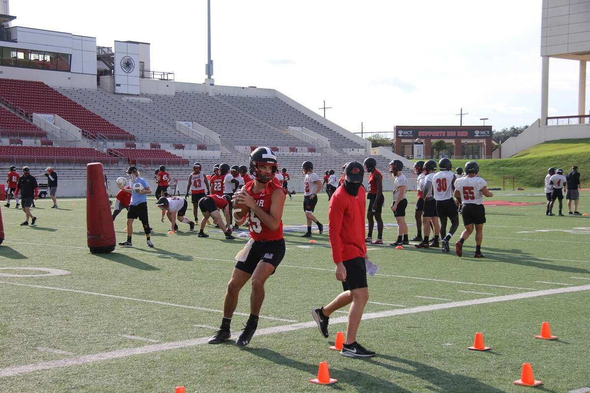 Lamar quarterbacks run drills Monday during the team's first practice.