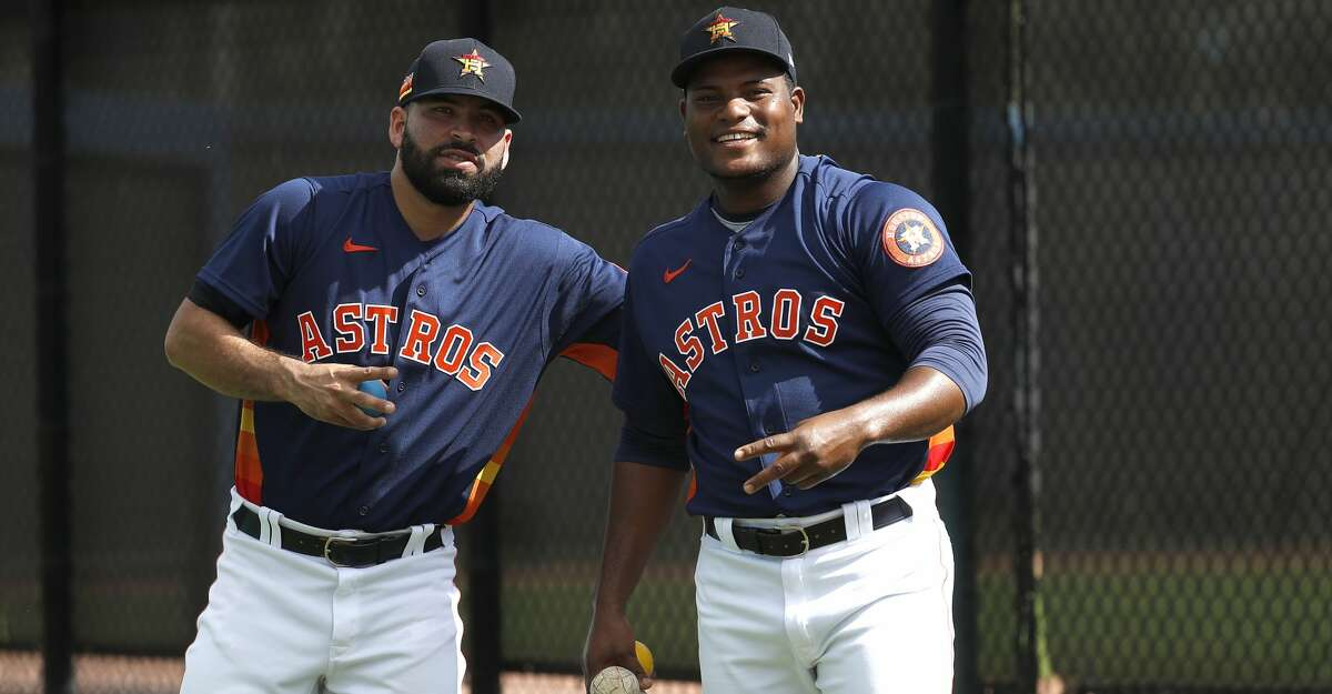 Houston Astros pitchers Jose Urquidy (65) and Framber Valdez (59) ham for the camera during the Houston Astros spring training workouts at the Fitteam Ballpark of The Palm Beaches, in West Palm Beach , Thursday, Feb. 20, 2020.