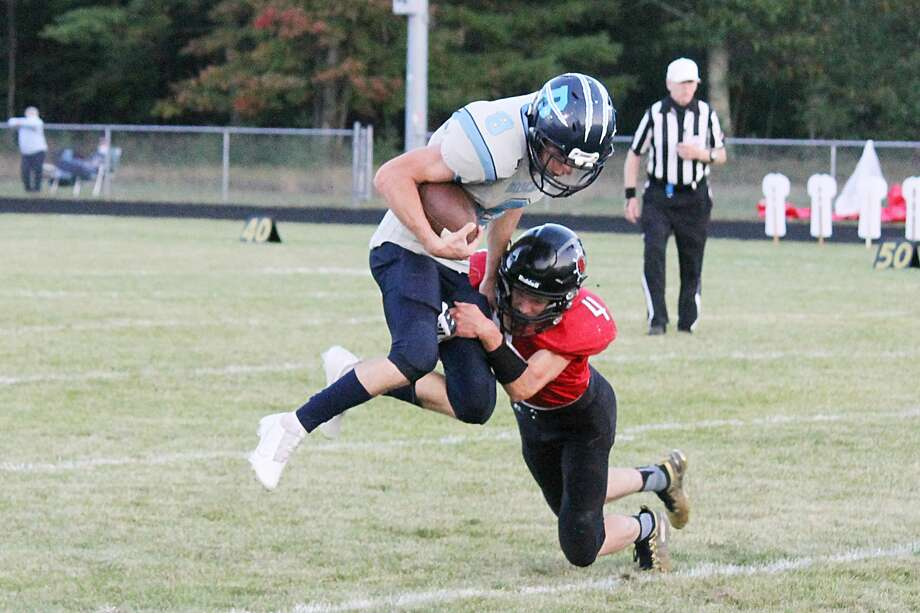 Brethren's Jake Schuch goes airborne for more yardage on Friday during the Bobcats' victory over Bear Lake. Photo: Robert Myers/News Advocate