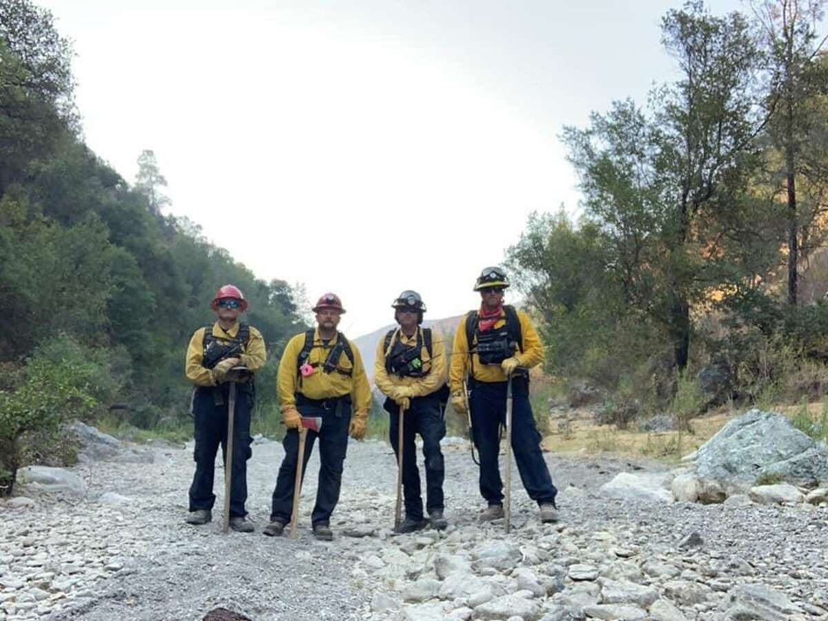 Fighting fires in the California wilderness are Schertz firefighters Carl Schultze (from left), Myron Boerger, Mack Melancon and Justin Schwersinske.