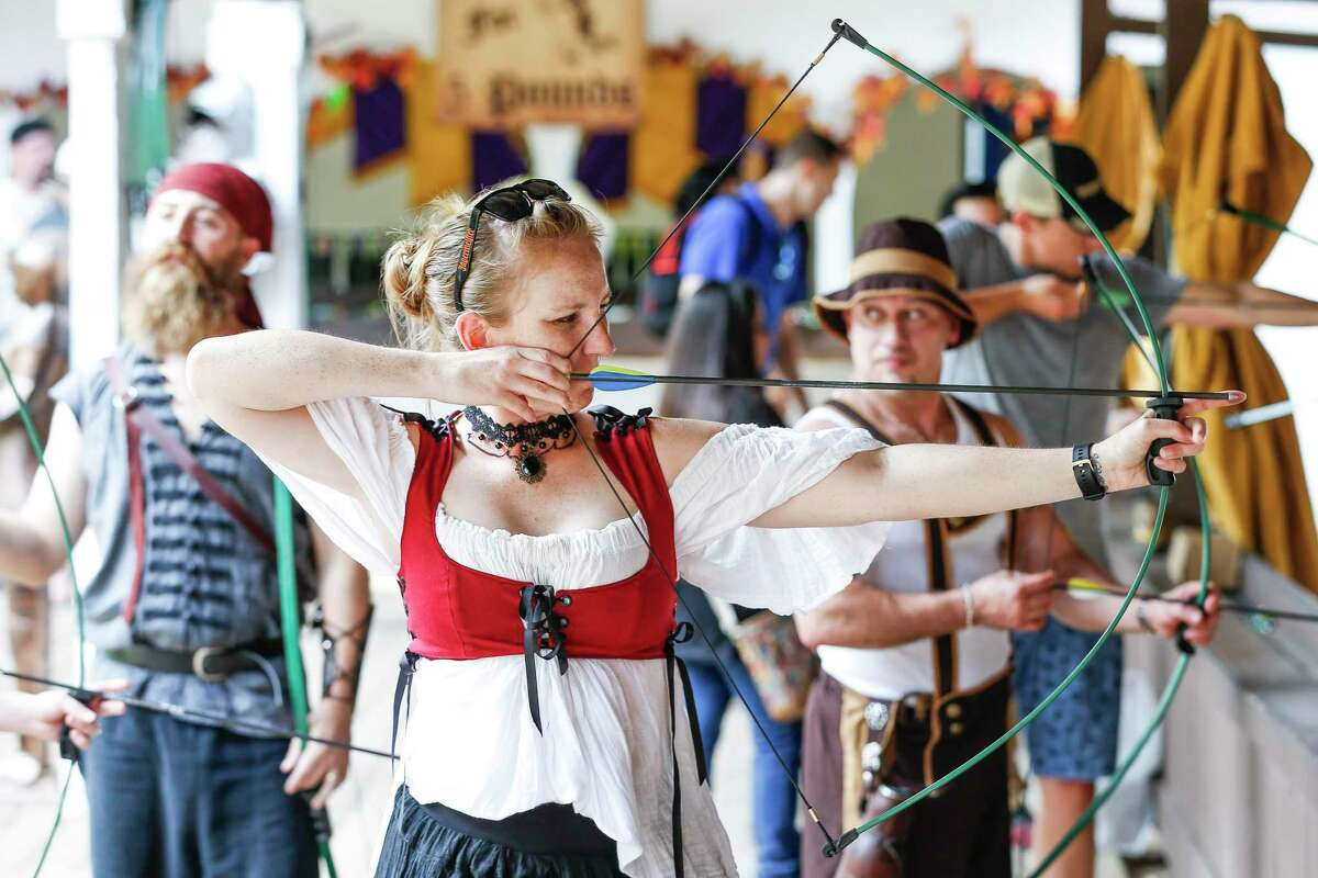 Michele Weichman aims an arrow while practicing her archery skills during the opening weekend of the Texas Renaissance Festival Sunday Sept. 30, 2018 in Houston.