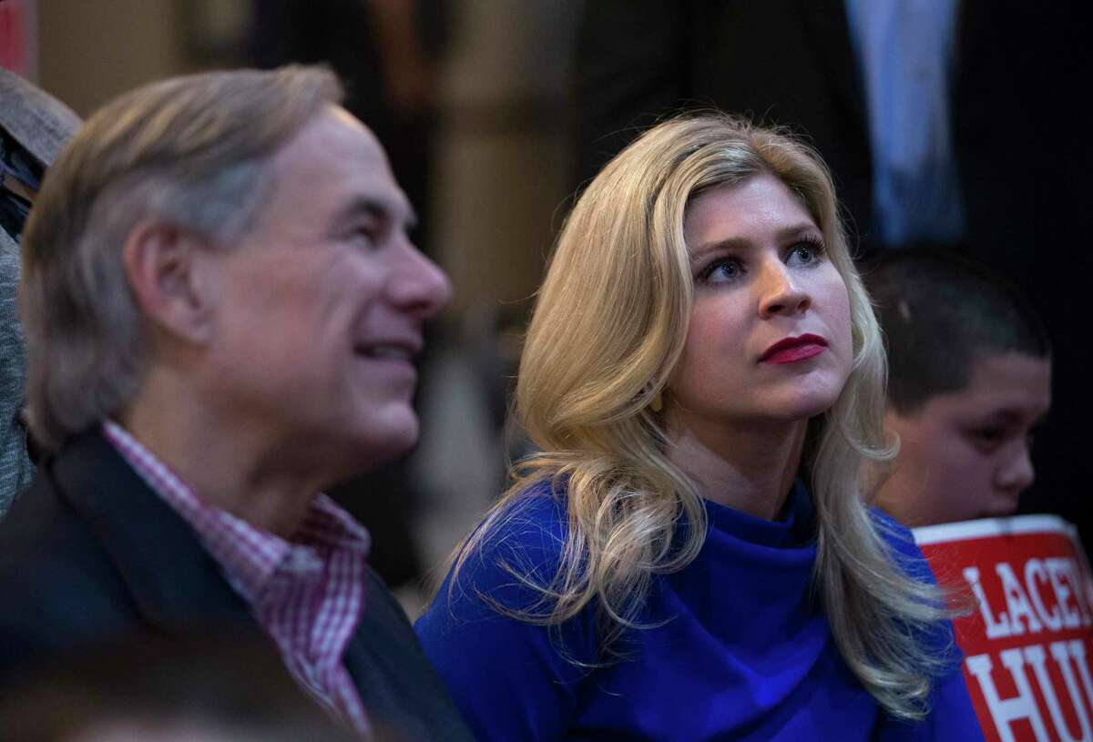 Lacey Hull, candidate for State Representative in House District 138, listening to a supporter have a conversation with Texas Gov. Greg Abbott during a campaign event Monday, Feb. 24, 2020, at Fratelli's Ristorante in Houston. The governor endorsed Hull on February 11, 2020.