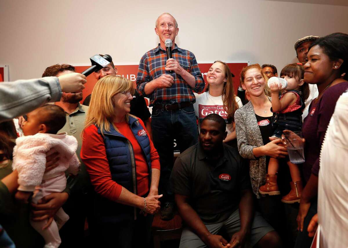 Republican Gary Gates speaks to his supporters standing in a chair at his election night watch party for the House District 28 special election at Gallery Furniture, Tuesday, Jan. 28, 2020, in Richmond.