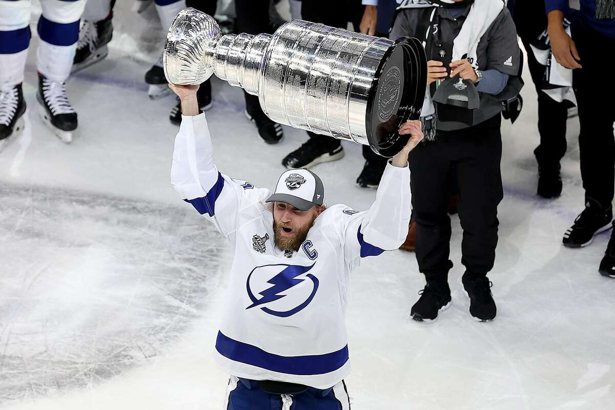 Center Steven Stamkos, who missed all but one of the Lightning's 16 postseason games in the bubble, skates with the Stanley Cup after the series-clinching victory over the Dallas Stars.