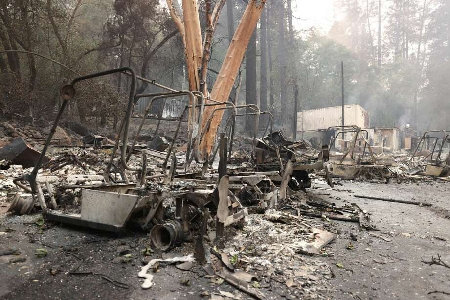 Burned golf carts sit in a parking lot at Meadowood Napa Valley luxury resort after the Glass Incident Fire moved through the area on September 28, 2020 in St. Helena, California. The fast-moving Glass Incident, originally called the Glass Fire, has burned over 11,000 acres in Sonoma and Napa counties. The fire is zero percent contained. Much of Northern California is under a red flag warning for high fire danger through Monday evening. Photo: Justin Sullivan/Getty Images / 2020 Getty Images