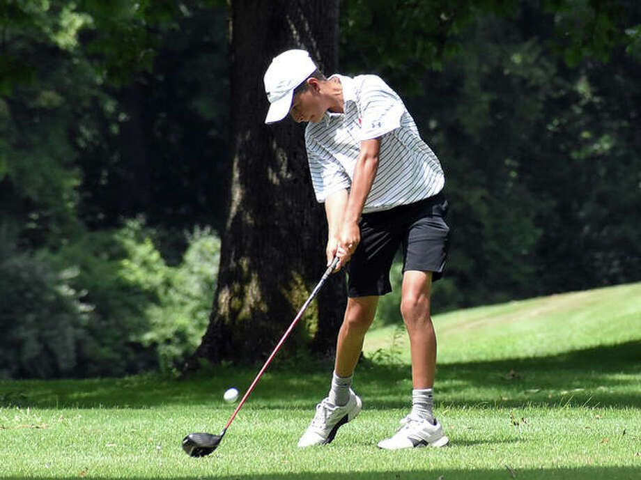 In this file photo, EHS freshman Drew Suhre drills a tee shot down the middle of the fairway. On Monday, Suhre recorded his first-ever hole-in-one during the Inaugural Crusader Classic at St. Clair Country Club in Belleville. Photo: Matt Kamp|The Intelligencer