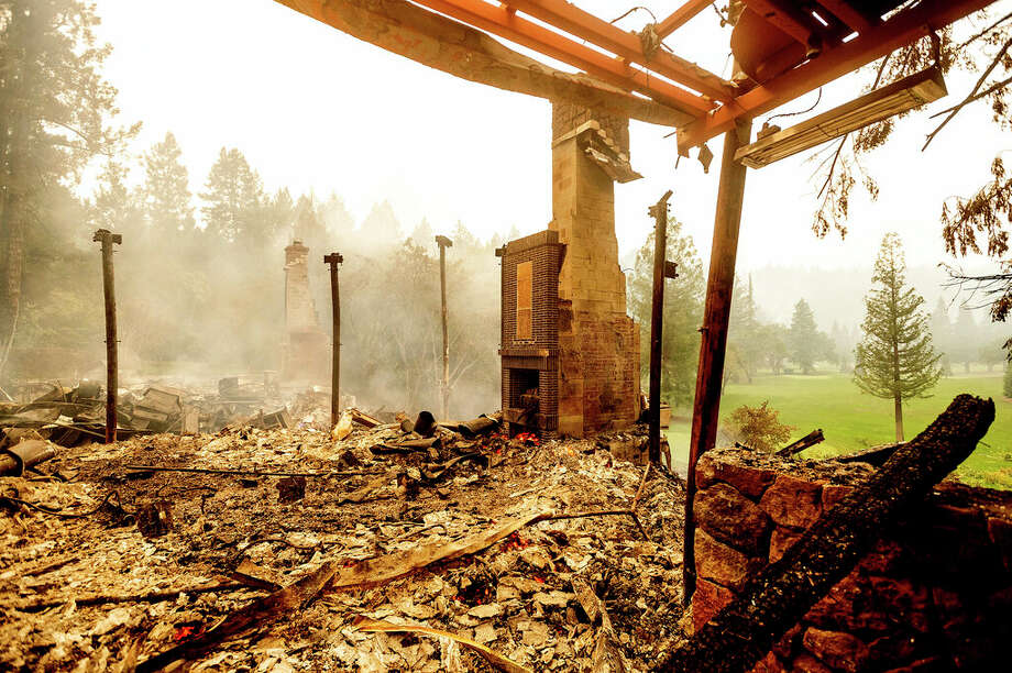A chimney stands, Monday, Sept. 28, 2020, at the Restaurant at Meadowood, which burned in the Glass Fire, in St. Helena, Calif. Photo: Noah Berger/AP / Copyright 2020 The Associated Press. All rights reserved