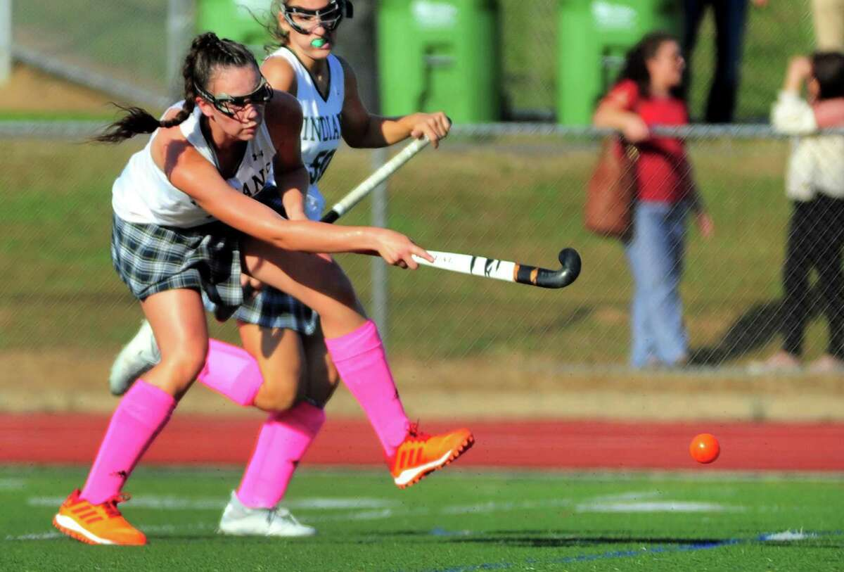 Guilford's Hannah Tillier hits the ball to score a goal against Daniel Hand during field hockey action in Guilford, Conn., on Tuesday Oct. 1, 2019.