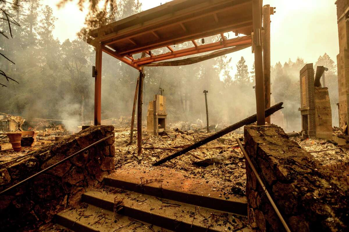 A staircase stands, Monday, Sept. 28, 2020, at the Restaurant at Meadowood, which burned in the Glass Fire, in St. Helena, Calif.