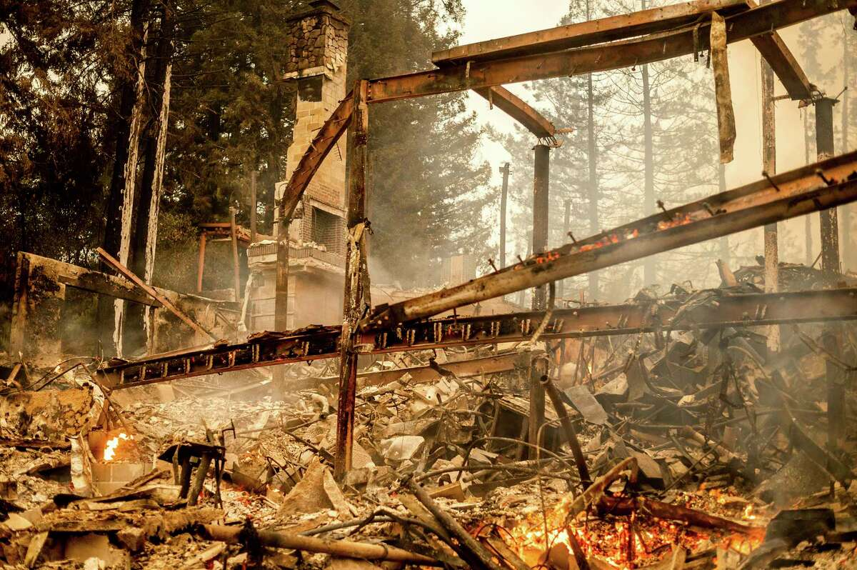 Charred framing remains, Monday, Sept. 28, 2020, at the Restaurant at Meadowood, which burned in the Glass Fire, in St. Helena, Calif.