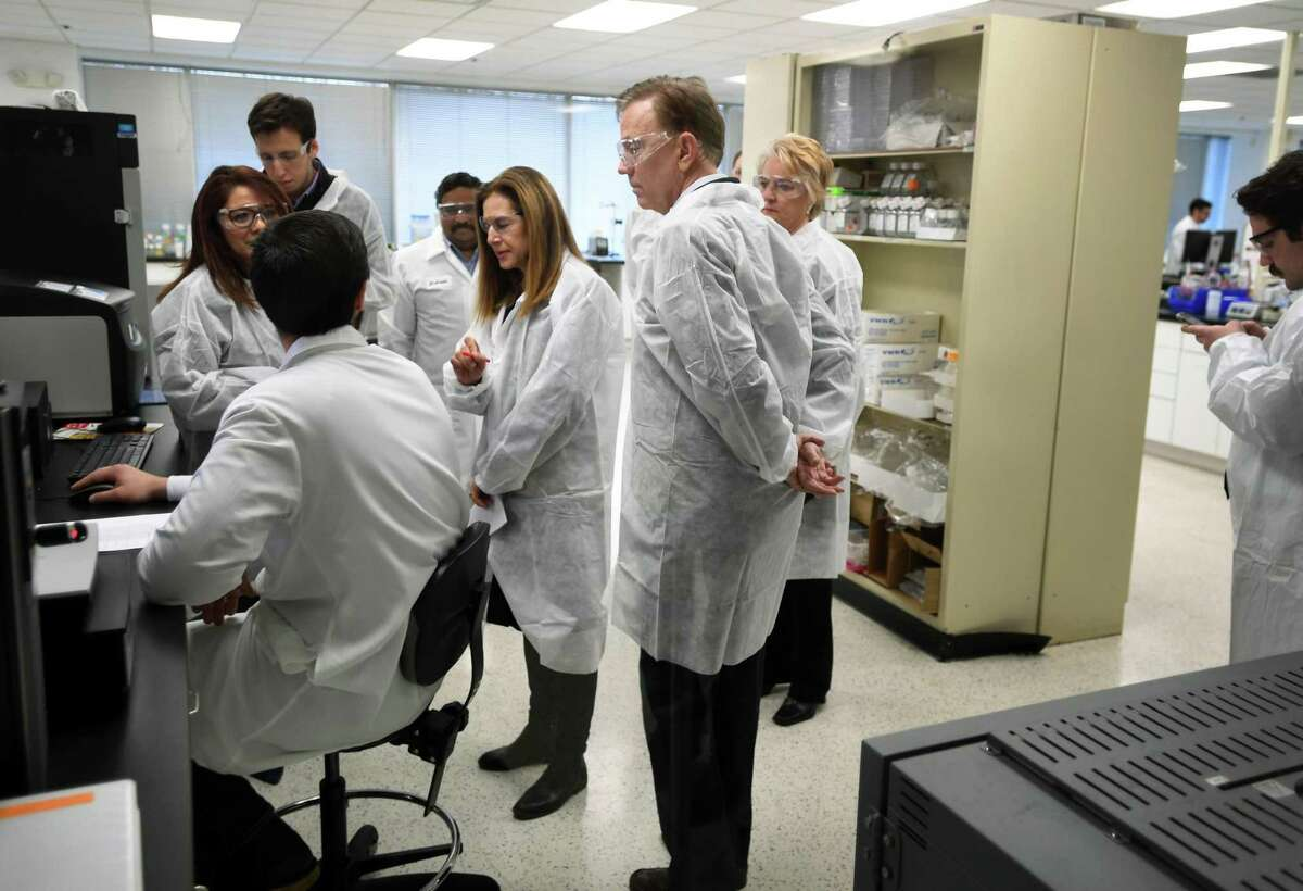 Governor Ned Lamont and Lt. Governor Susan Bysiewicz tour the lab at Protein Sciences Corp. in Meriden on March 12, 2020. The company, owned by Paris-based Sanofi, is working on a vaccine for the coronavirus.