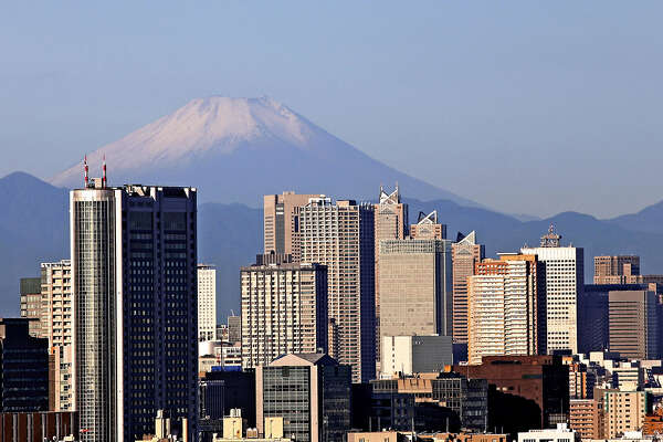 Snowcapped Mt. Fuji is seen from central Tokyo on Sept. 28, 2020 as clear autumn air made it possible to enjoy stunning views of the mountain from the capital. The Kofu Local Meteorological Office on Monday confirmed the first snowfall on Mt. Fuji this season, 24 days earlier than last year.