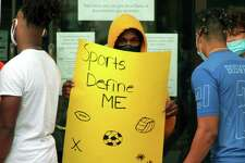 Danbury High School athletes protest against the cancellation of high school sports after a COVID-19 spike in the city at Danbury City Hall in Danbury, Conn., on Tuesday Aug. 25, 2020.