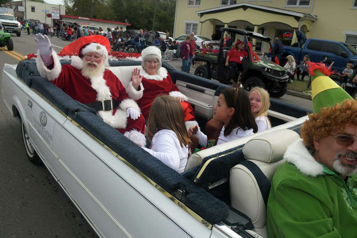 Santa and Mrs. Claus, left, along with Elf Wesley Burke, right, bring up the rear of the Tomball Christmas Parade on Main Street in downtown Tomball on Nov. 17, 2018.