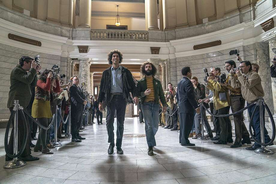 """Sacha Baron Cohen, center left, and Jeremy Strong in """"The Trial of the Chicago 7."""" Directed by Aaron Sorkin, it features Sasha Baron Cohen (""""Borat""""), Eddie Redmayne (""""Fantastic Beasts""""), Joseph Gordon-Levitt (""""Inception"""") and Michael Keaton (""""Spotlight""""), among others. While it takes place almost 900 miles away, there are actually a lot of ties to Connecticut, in particular New Haven. Photo: Niko Tavernise, Netflix"""