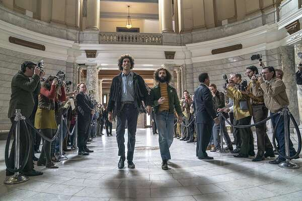 """Sacha Baron Cohen, center left, and Jeremy Strong in """"The Trial of the Chicago 7."""" MUST CREDIT: Niko Tavernise/Netflix"""
