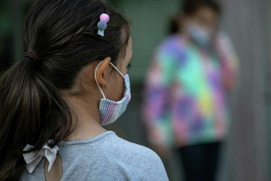 A Superior Court judge is considering whether to allow two doctors to testify in a lawsuit challenging the state's requirement that students wear masks in schools. Photo: John Moore / Getty Images / 2020 Getty Images