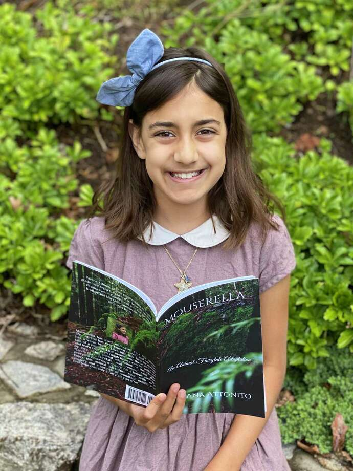 """Nine-year-old Pavana Attonito, a fourth grader at Hindley Elementary School, has just self-published her first book, """"Mouserella."""" Photo: Contributed /"""
