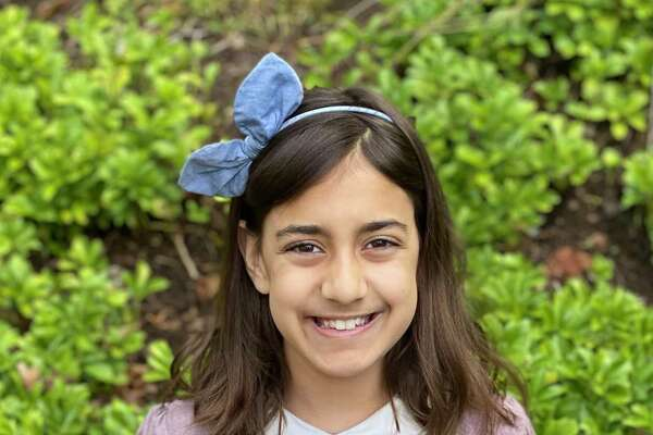 """Nine-year-old Pavana Attonito, a fourth grader at Hindley Elementary School, has just self-published her first book, """"Mouserella."""""""