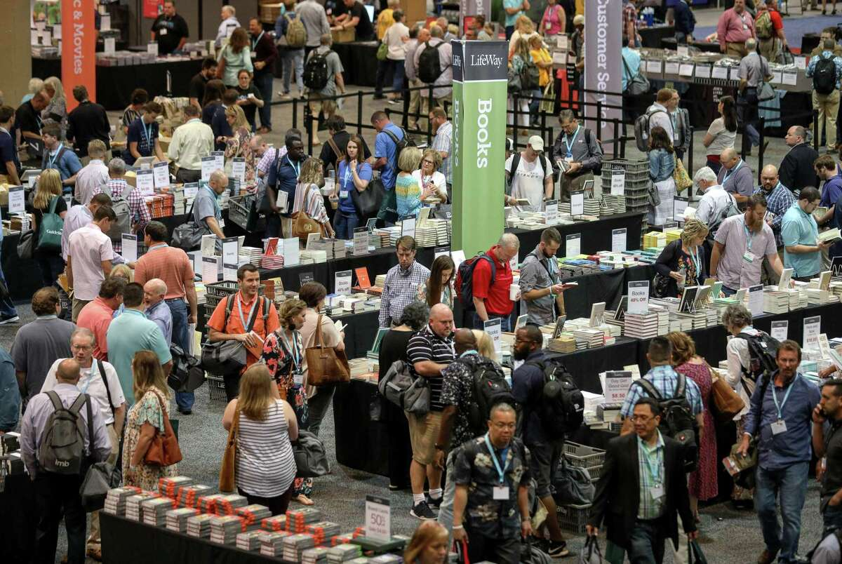 People look for books at tables set up by LifeWay Christian Resources, at the Birmingham-Jefferson Convention Complex, on the eve of the Southern Baptist Convention's annual meeting on Monday, June 10, 2019, in Birmingham, Ala.
