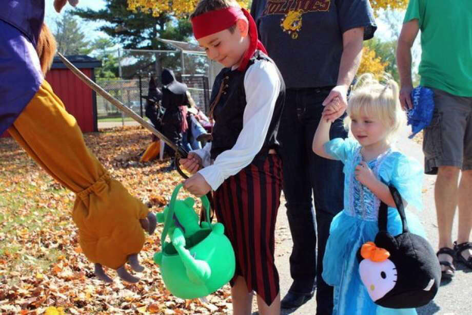 In this file photo, children participate in a previous Halloween in the Park. Photo: Pioneer File Photo