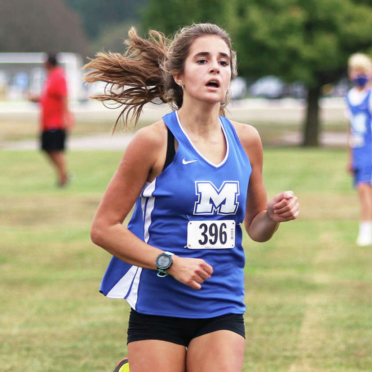 Marquette Catholic sophomore Kailey Vickrey approaches the finish in third place at last Wednesday's Alton Invite at Moore Park in Alton. Vickrey is one of 11 underclassmen among the 12 boys and girls runners in the Explorers' program.