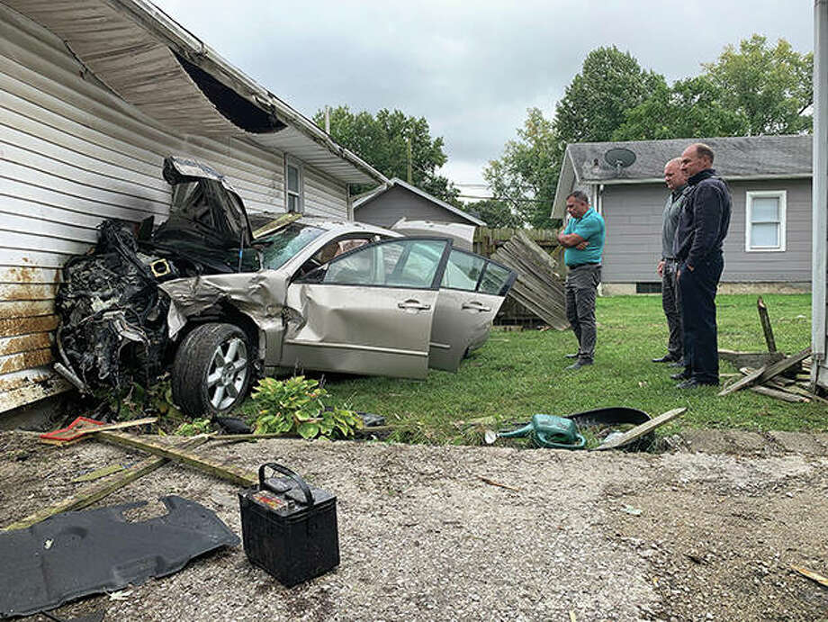 A stolen car hit a house and garage Monday. Police are looking for the thief. Photo: Photo Courtesy Visual Paradise Films