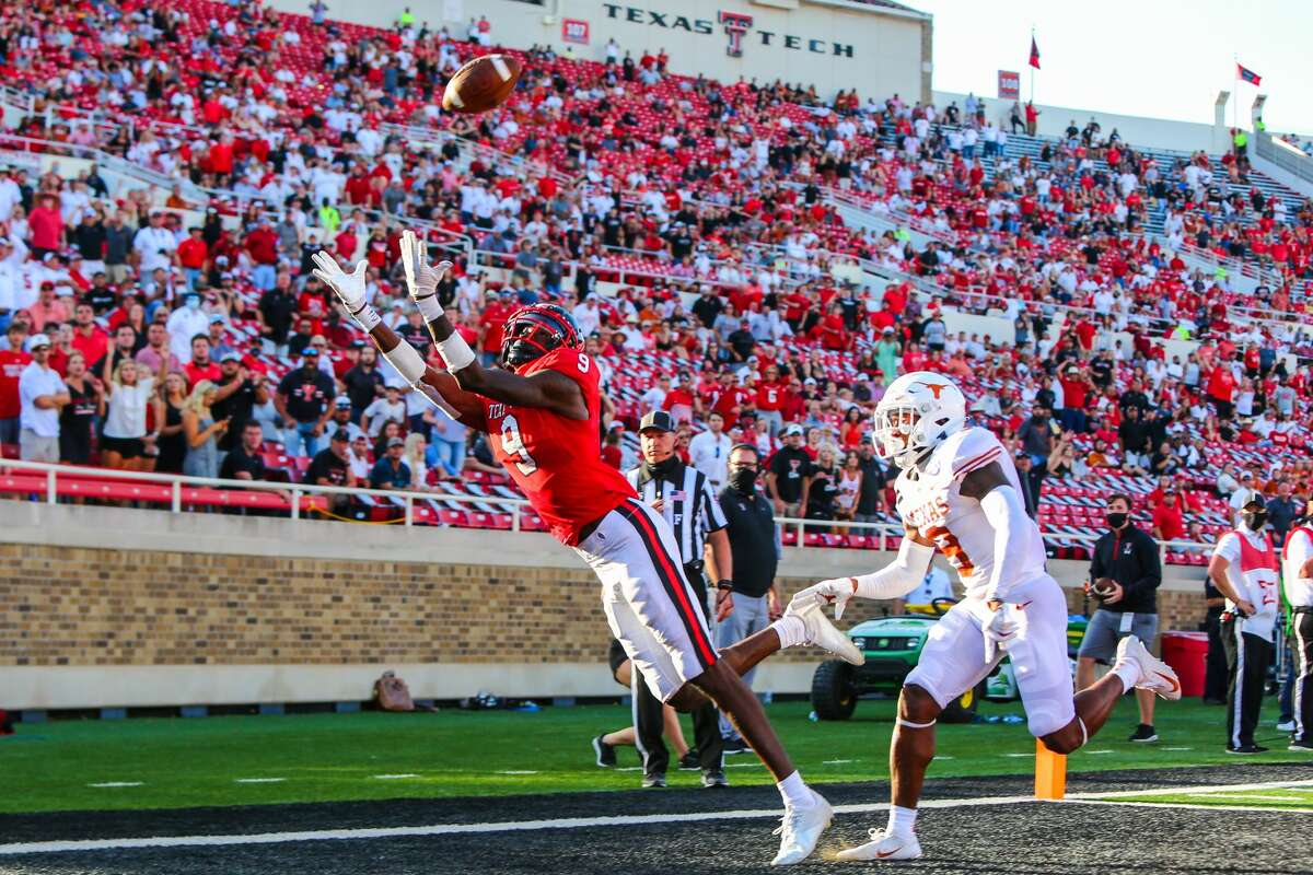 LUBBOCK, TEXAS - SEPTEMBER 26: Receiver T.J. Vasher #9 of the Texas Tech Red Raiders catches a touchdown pass against cornerback Josh Thompson #9 of the Texas Longhorns during the second half of the college football game on September 26, 2020 at Jones AT&T Stadium in Lubbock, Texas. (Photo by John E. Moore III/Getty Images)