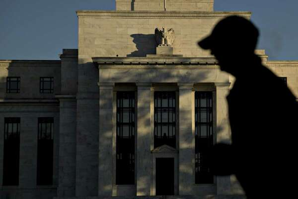 A runner passes the Federal Reserve in Washington, D.C., on Nov. 18, 2016.
